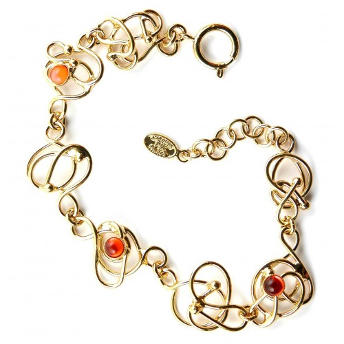Bracelet doré, fin et délicat avec trois petites pierres