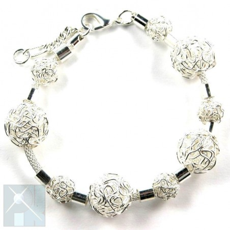 Bracelet avec des boules en fil, bijou fantaisie.