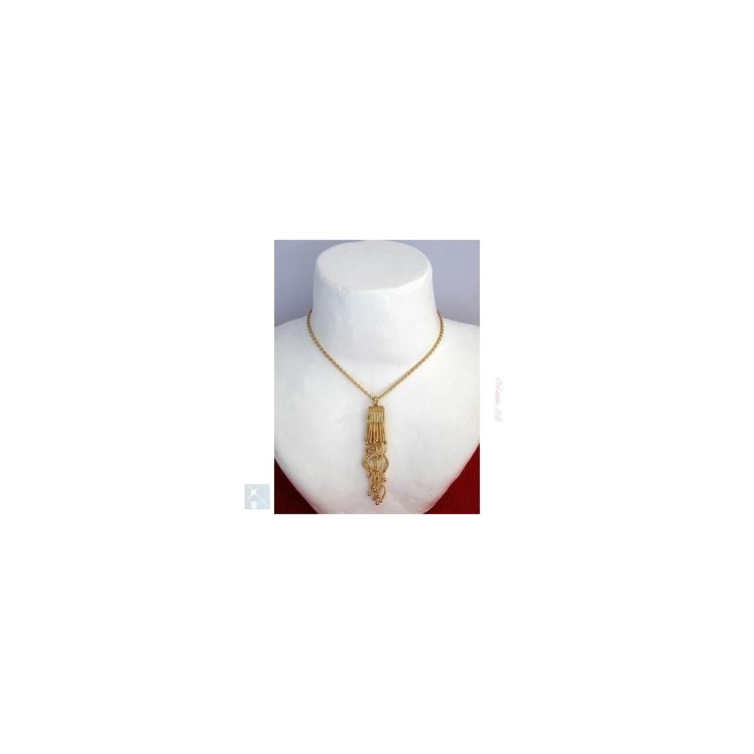 Pendentif doré, création de bijoux artisanaux.