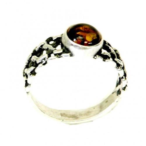 Très originale la bague en argent massif et son anneau tressé