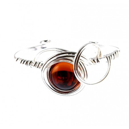 Bracelet rigide-bijou fait main avec une pierre de couleur topaze.