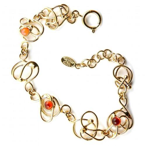 Bracelet fantaisie avec des cabochons oranges. Bijou artisanal fait main.