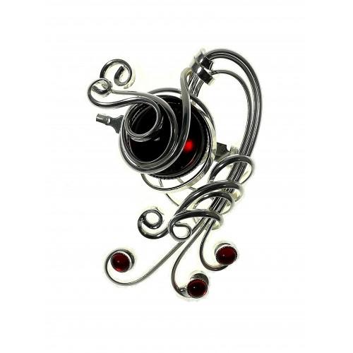 Broche argent- bijou sensuel et rétro avec un cabochon rouge.