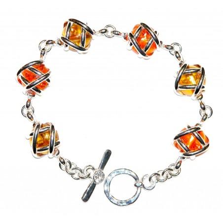Bracelet argent avec des pierres de couleur orange et jaune topaze.