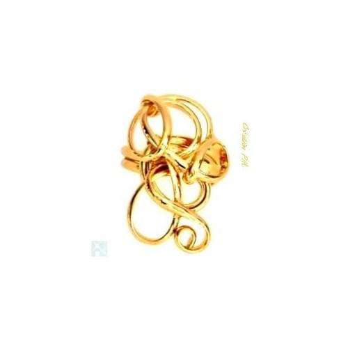 Bague en deux fils dorés. Bijou fabriqué par un artisan d'art.