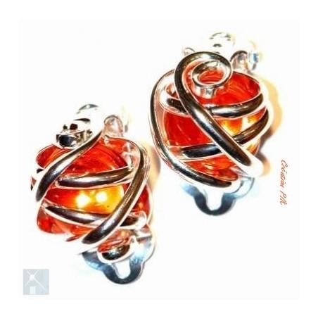Boucles d'oreilles clips argent et orange.