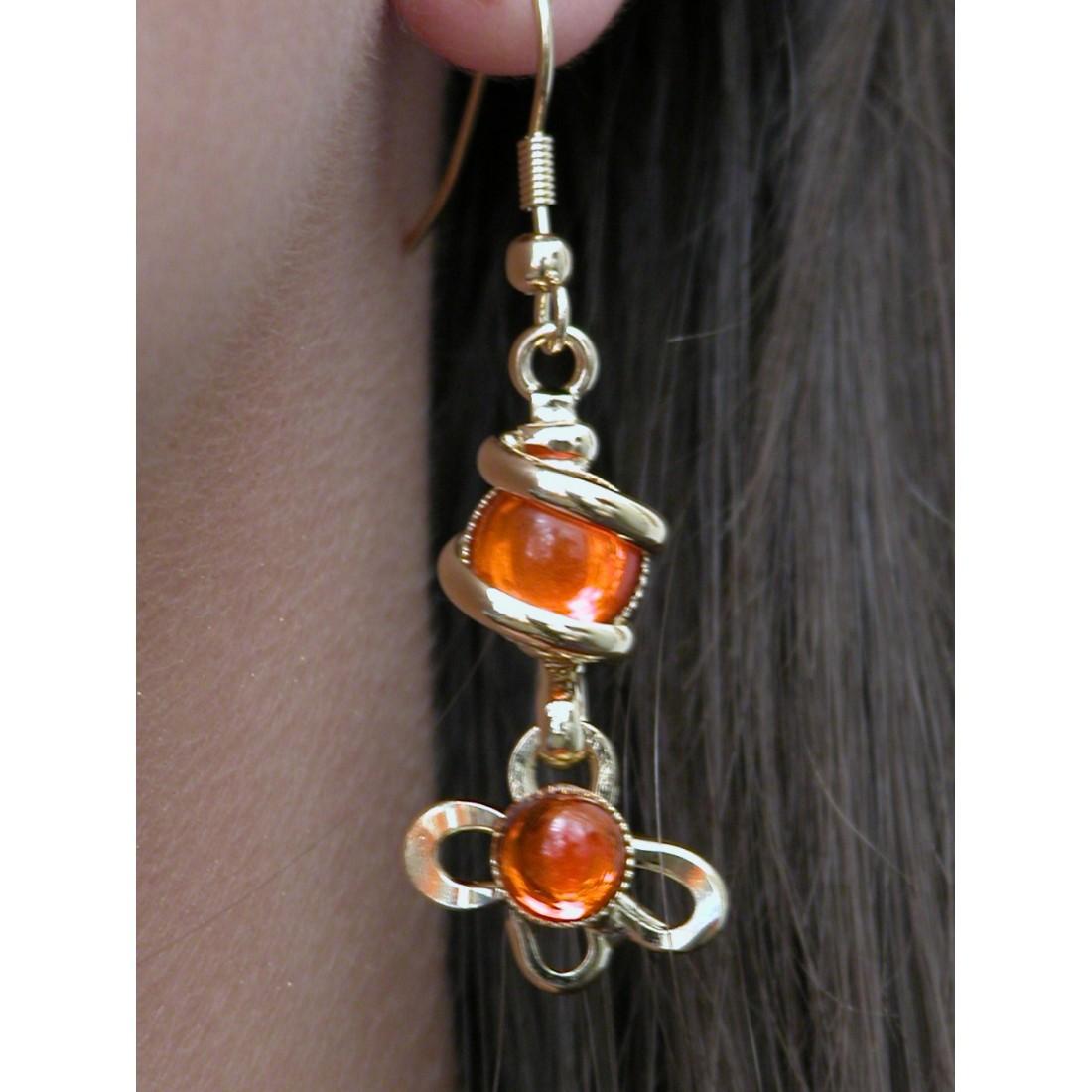 Boucles d'oreilles fleurs oranges.
