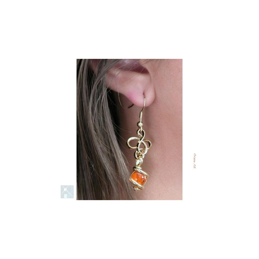 Boucles d'oreilles en fils entrelacés, oranges.